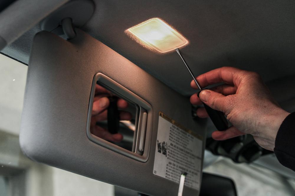 Vanity Visor LED Light Install Step #1 - Pop Tabs on Light Bulb Cover